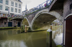 Cozy city bridge in netherlands, utrecht. Dutch city during the weekend day with people enjoying beautiful autumn day Stock Photo