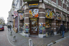 Cozy city shop with a lot of colorful stickers netherlands, utrecht. Dutch city during the weekend day with people enjoying beautiful autumn day Royalty Free Stock Photography