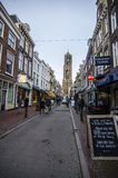 Cozy city street in netherlands, utrecht. Dutch city during the weekend day with people enjoying beautiful autumn day Stock Image