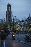 Cozy city street in netherlands, utrecht. Dutch city during the weekend day with people enjoying beautiful autumn day Royalty Free Stock Photography