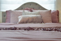 Cozy and classic bedroom interior with pillows Royalty Free Stock Images
