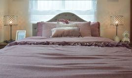 Cozy and classic bedroom interior with pillows and reading lamp Royalty Free Stock Photos