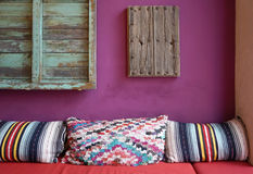 Cozy colorful pattern throw cushion. On the red seat stock photo