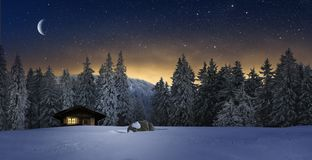 Free Cozy Cottage In Wintertime At Night Stock Images - 163267994