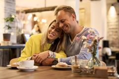 Cozy Couple Sitting In Cafe Stock Images