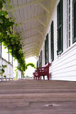 Cozy covered wooden gallery with grapes and benches Stock Photography