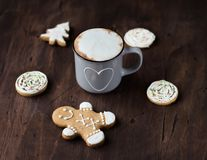 Cozy Cup of cocoa with Christmas gingerbread on a wooden table royalty free stock image