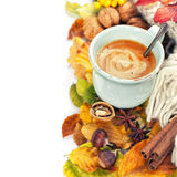 Cozy cup of coffee and autumn leaves Stock Image