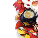 Cozy cup of coffee and autumn leaves Stock Images