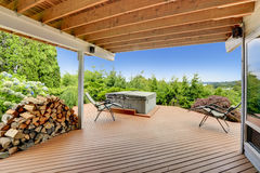 Cozy deck with jacuzzi overlooking scenic nature Royalty Free Stock Images
