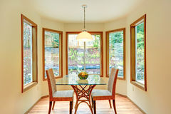 Cozy dinig area by the round wall with windows. Stock Photo