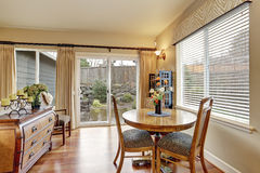 Cozy dining area with hardwood floor and backyard view Royalty Free Stock Images