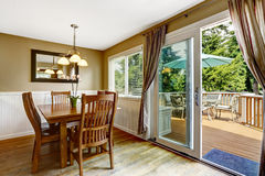 Cozy dining area and walkout deck Stock Photography