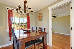 Cozy dining room with large oak table Royalty Free Stock Images
