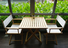 Cozy dining set by the window for two people Stock Photos