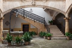 Cozy european patio with well and stairs Stock Photos