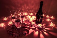 Cozy evening with glasses of champagne. For celebrations, special moments and new years eve. Warm decoration light, candles and b royalty free stock photo