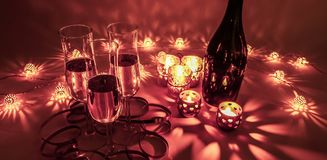 Cozy evening with glasses of champagne. royalty free stock image