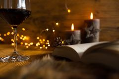 Cozy evening with wine and a good book stock images