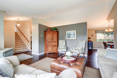 Cozy family room interior with traditional American design. Cozy family room interior with grey walls, sloped ceiling and wide plank wood floors. The room is Royalty Free Stock Images