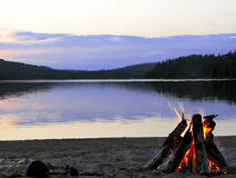 Cozy Fire on Lake. Enjoying beach campfire at sunset on Rankin Lake, Northern Ontario Stock Photos