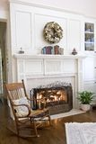 Cozy fireplace. And rocking chair Royalty Free Stock Photo