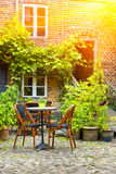 Cozy French Cafe terrace In Old Small  City Stock Photo