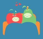 Cozy Fruit Couple on Sofa Stock Photos