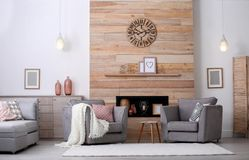 Cozy furnished apartment with niche in wooden wall. And armchair. Interior design stock images