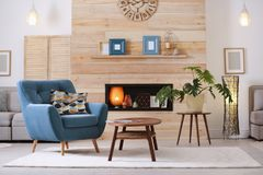 Cozy furnished apartment with niche in wooden wall. And armchair. Interior design royalty free stock photo