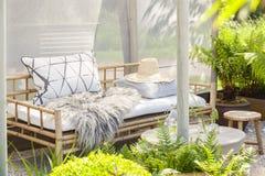 Cozy garden seating Stock Image