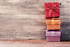 Cozy gifts on a wooden surface Royalty Free Stock Images