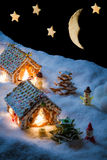 Cozy gingerbread cottage in snow Royalty Free Stock Image