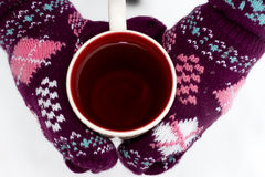Cozy gloves hold a mug Royalty Free Stock Photography