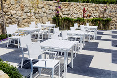 Cozy greek  restaurant with white chairs and tables Royalty Free Stock Photos
