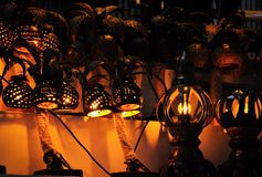 Cozy handmade lamps made of coconut nuts with perforation - a souvenir in Thailand royalty free stock image
