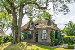 Cozy historic cottage in Dwarsgracht Holland. Beautiful traditional house with a thatched roof in Dwarsgracht - Giethoorn  Holland Royalty Free Stock Photography