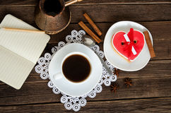 Cozy holiday. Mug coffee, notepad and pencil, cezve. Top view Royalty Free Stock Images