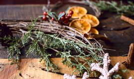 Cozy Holiday Old fashioned grape vine Wreath with sliced dried orange and cinnamon stick spice stock photo