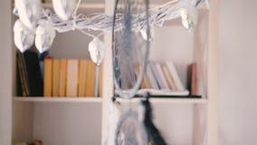 Cozy home art studio decor atmosphere dreamcatcher. Home art studio. Cozy workroom. Creative decor atmosphere. Artist taking watercolor sketchbook. Dreamcatcher stock video footage