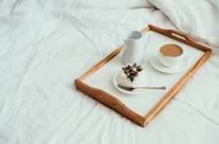 Cozy home breakfast in bed in white bedroom interior. With new linen bedding stock images