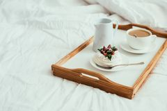 Cozy home breakfast in bed in white bedroom interior. With new linen bedding stock photography