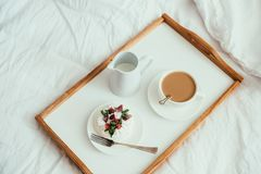 Cozy home breakfast in bed in white bedroom interior. With new linen bedding royalty free stock images