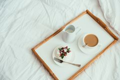Cozy home breakfast in bed in white bedroom interior. With new linen bedding stock photos