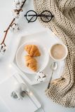 Cozy home breakfast, warm blanket, coffee and croissant on white Royalty Free Stock Image