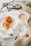 Cozy home breakfast, warm blanket, coffee and croissant on white Royalty Free Stock Images