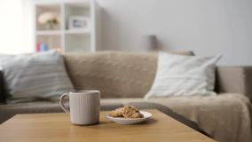 Chocolate oatmeal cookies and mug with hot drink stock footage