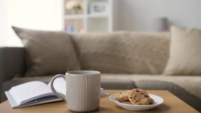 Chocolate oatmeal cookies and mug with hot drink stock video