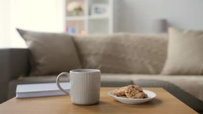 Chocolate oatmeal cookies and mug with hot drink stock video footage