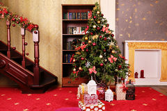 Cozy home interior, with Christmas tree and New Year decoration. Holiday photo of cozy home interior, with Christmas tree and New Year decoration Royalty Free Stock Photo